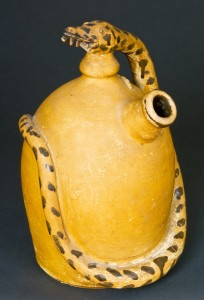 Albany Slip Decorated Stoneware Harvest Jug with Rattlesnake Handle. To be sold in the auction of Wm. Kelly Collection on January 30.