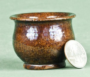 Miniature redware pot made by Absalom Bixler in Lancaster County, Pennsylvania.