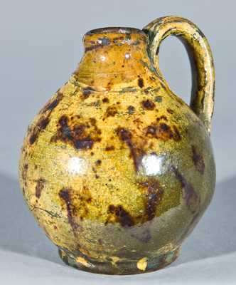 Miniature Glazed Redware Jug, New England origin.