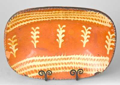 Redware Loaf Dish with Profuse Slip Decoration, Eastern U.S. Origin.