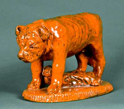 Redware Figure of a Dog Guarding a Baby