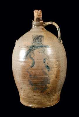 Ohio Stoneware Jug with Man's Head Decoration