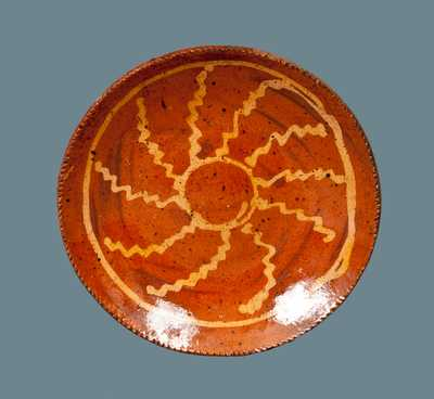 Redware Plate with Slip-Decorated Wheel Decoration