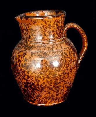 Pennsylvania Redware Pitcher with Speckled Manganese Decoration