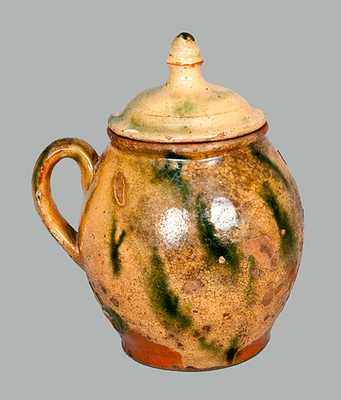 Lidded Redware Jar with Yellow and Green Decoration