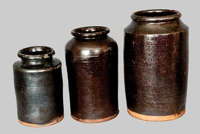 Lot of Three: Cylindrical Redware Jars with Manganese Glaze