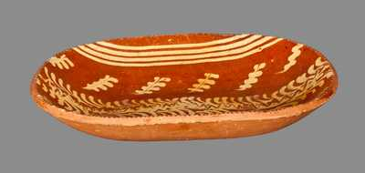Redware Loaf Dish with Profuse Slip Decoration