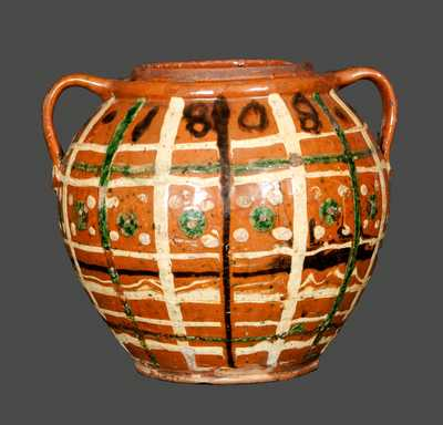 Outstanding Ovoid Redware Jar Dated 1808 and Decorated with Green, Brown and Yellow Slip