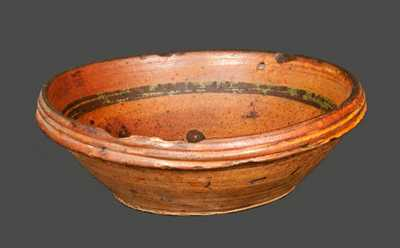 Rare Small Redware Bowl with Slip-Decorated Floral Design, probably Hagerstown, MD area, early 19th century