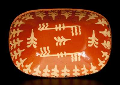 Outstanding American Redware Loaf Dish with Profuse Slip Decoration