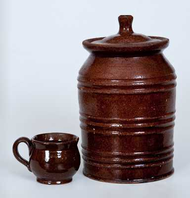 Two Pieces of Glazed Redware, Pennsylvania or New England origin, 19th century.