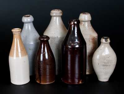 Lot of Seven: Stoneware Bottles Including M. EATON / MEAD Marked Example