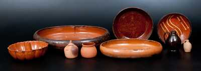 Lot of Nine: Redware Articles incl. Diminutive Jug, Slip-Decorated Plate, and Bank