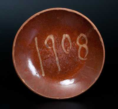 Rare Slip-Decorated Redware Plate, probably PA origin, Dated 1908