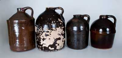 Lot of Four: Albany-Slip Stoneware Jugs incl. Peoria Pottery Example and Three Examples Found in Alabama