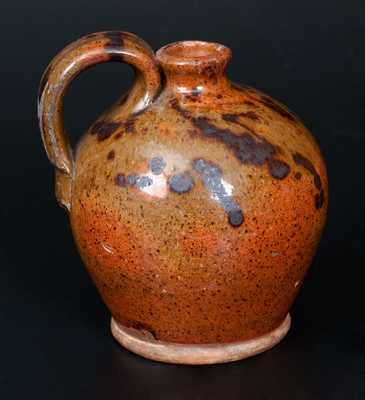 Diminutive Redware Jug with Manganese Splotches
