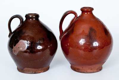 Lot of Two: Ovoid New England Redware Jugs with Manganese Sponging