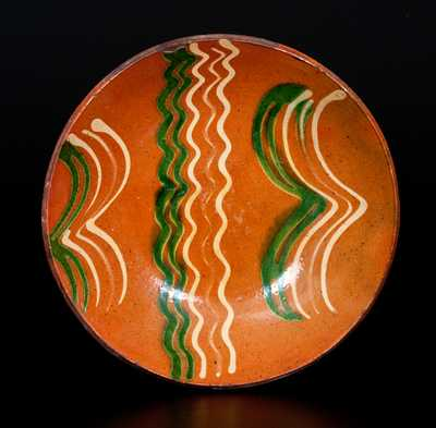 Exceptional Slip-Decorated Berks County, PA Redware Plate