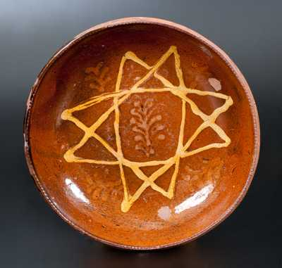 Unusual Redware Dish with Slip Star and Foliate Sprig Decoration