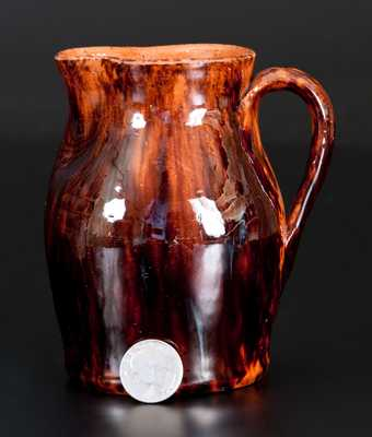 Fine JOHN BELL, Waynesboro, PA, Redware Cream Pitcher with Sponged Manganese Decoration