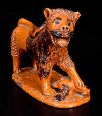 Exceedingly Rare Pennsylvania Redware Figure of a Lion Standing atop a Bird