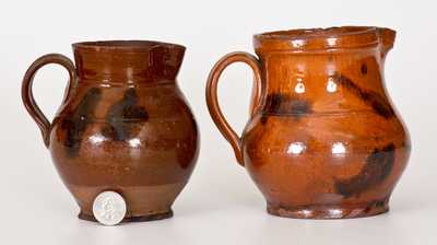 Lot of Two: Small Redware Pitchers with Manganese Decoration