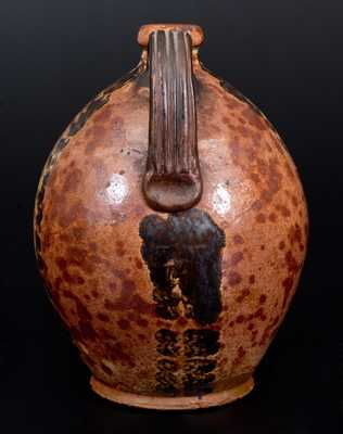 Rare and Fine Glazed Maine Redware Jug