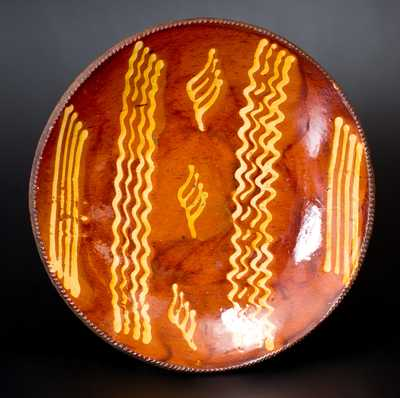 Exceptional Large-Sized Philadelphia Redware Charger w/ Slip Decoration, early 19th century