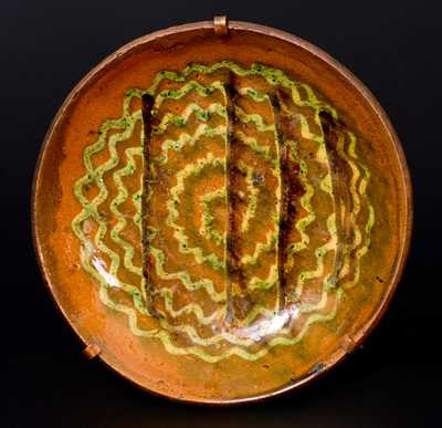 Pennsylvania Redware Plate with Elaborate Three-Color Slip Swirl Decoration