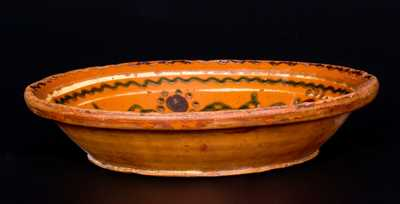Rare Slip-Decorated Redware Plate w/ Bird Motif, possibly North Carolina, early 19th century