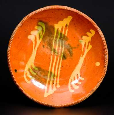 Rare Pennsylvania Redware Plate with Yellow and Green Slip Decoration