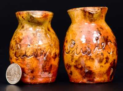 Rare Pair of Miniature Redware Presentation Pitchers, attrib. Jacob Medinger, Montgomery Co, PA