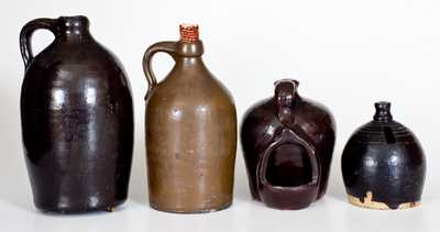 Lot of Four: Stoneware Vessels with Albany Slip Glaze incl. Chick Waterer, Bank, and Two Jugs