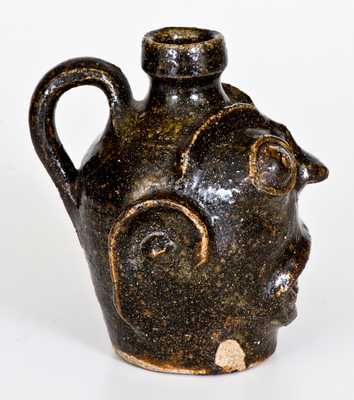Rare and Important Diminutive Edgefield, South Carolina, Stoneware Face Jug