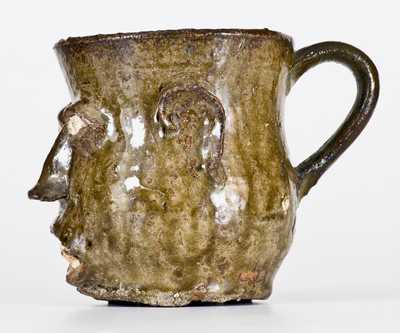 Extremely Rare and Important Edgefield, South Carolina, Stoneware Face Cup