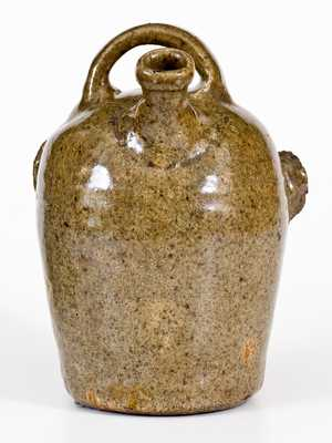 Extremely Rare and Important Edgefield, South Carolina, Stoneware Face Harvest Jug
