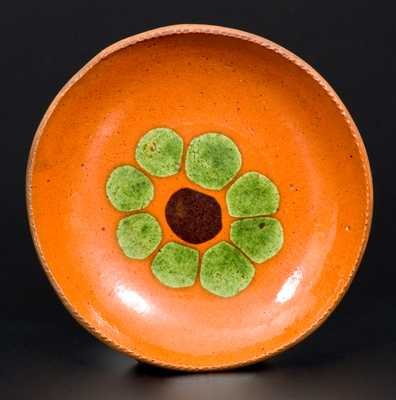 Very Fine Small Redware Plate with Two-Colored Slip Flower Decoration