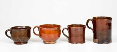 Four Glazed Redware Drinking Vessels, American, 19th century