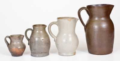 Four Salt-Glazed Stoneware Pitchers, primarily Southern origin, mid to late 19th century