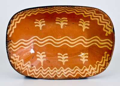 Fine Slip-Decorated Redware Loaf Dish, Philadelphia, PA origin, circa 1825