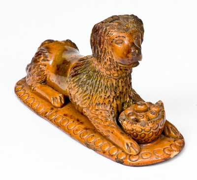Rare Redware Figure of a Recumbent Dog with Basket, attributed to the John Bell Pottery, Waynesboro, PA