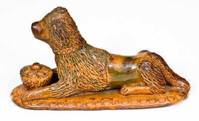 Rare and Important Redware Figure of a Dog with Basket, attrib. John Bell, Waynesboro, PA
