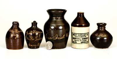 Lot of Five: Miniature Albany-Slip Stoneware Advertising Jugs with Urn