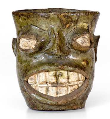 Important Alkaline-Glazed Stoneware Face Cup, Edgefield District, SC origin, circa 1855-1870