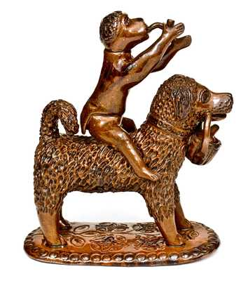 Large-Sized Pennsylvania Redware Figure of a Dog with Monkey Rider