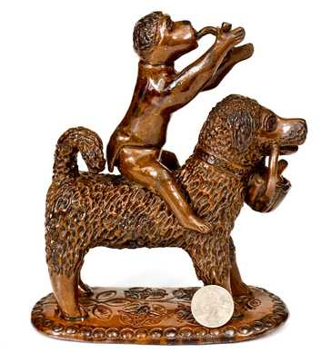 Exceptional Large-Sized Pennsylvania Redware Figure of a Dog with Monkey Rider