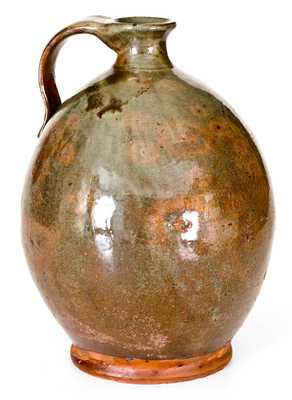 Exceptional Ovoid New England Redware Jug with Vibrant Glaze