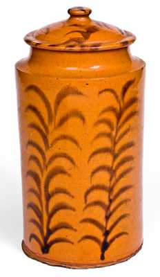 Rare and Important Slip-Decorated New England Redware Jar with Lid