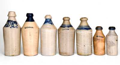 Lot of Seven: Stoneware Bottles with Cobalt Highlights and Impressed Names
