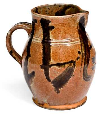 Rare and Important Slip-Decorated New England Redware Pitcher